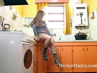 Striptease Skyler has hot and orgasmic fun in her kitchen
