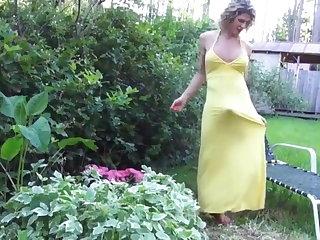 BEAUTIFUL MATURE TRANNY IN  LONG YELLOW DRESS