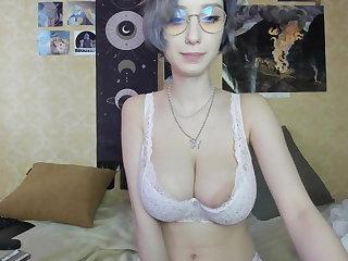 Ukrainian Busty Ukrainian Mari tittyfucks a dildo and shows pussy